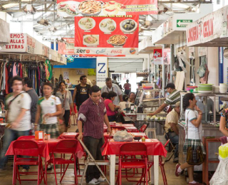 Santiago, with a vibrant and food market and abundance of cocina economicas serving up tortas of cochinita pibil, lechon, salbutes and panuchos (Yucatan's version of Mexican tacos and tostadas).